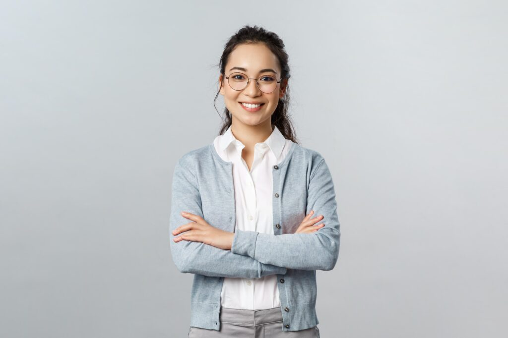 Career, business and education concept. Portrait of cheerful asian girl ready to start online lesson
