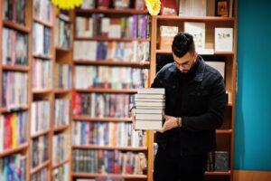Arab student man at library
