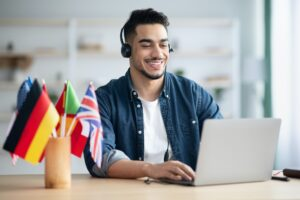 Happy arab guy student learning foreign language online