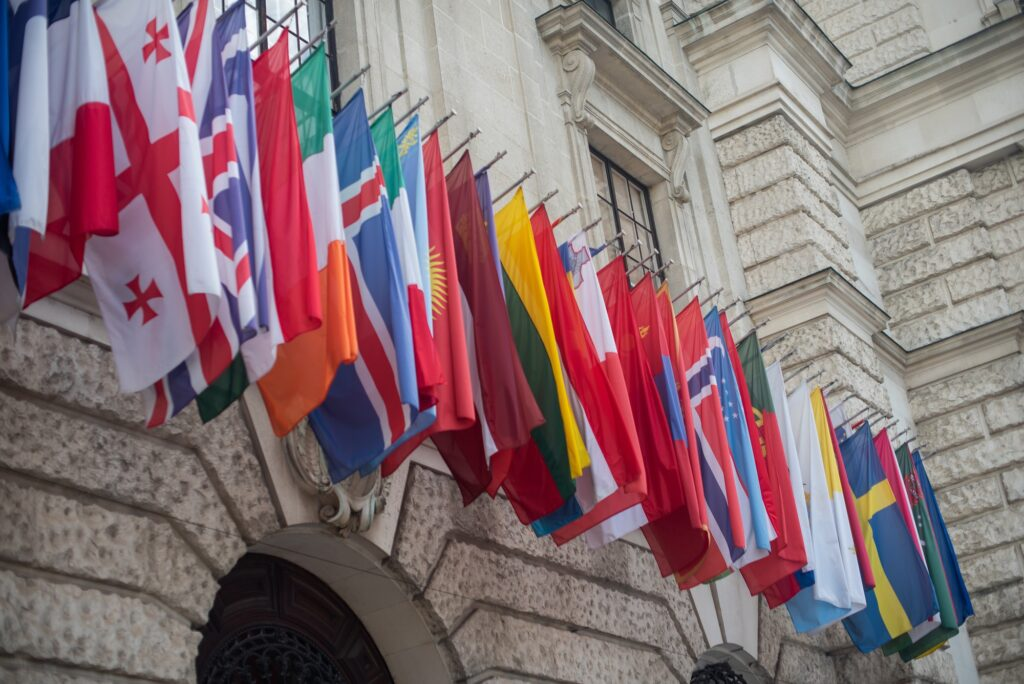 assortment of various countries flags seen on balcony of building