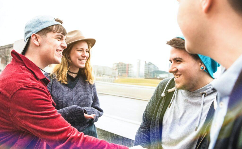 Best friends millennials having genuine fun at urban area in Berlin