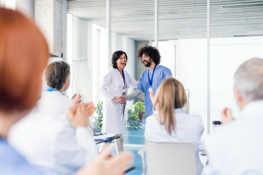 Group of doctors on medical conference, shaking hands