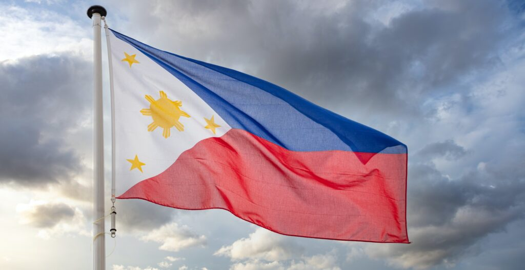 Philippines flag waving against cloudy sky