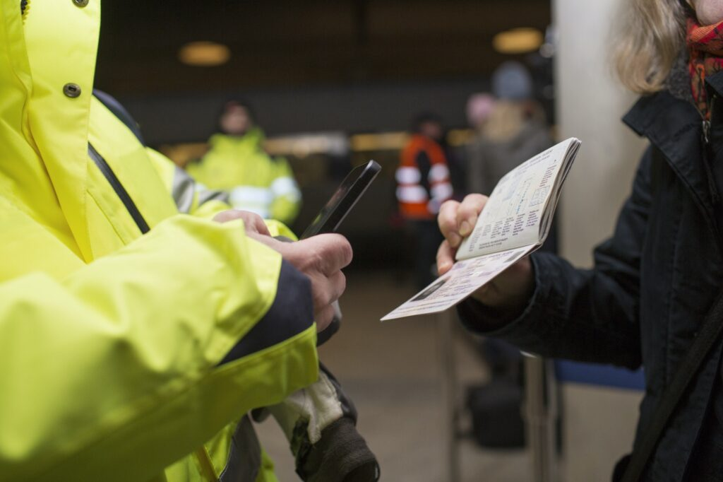 Cropped image of security photographing passport