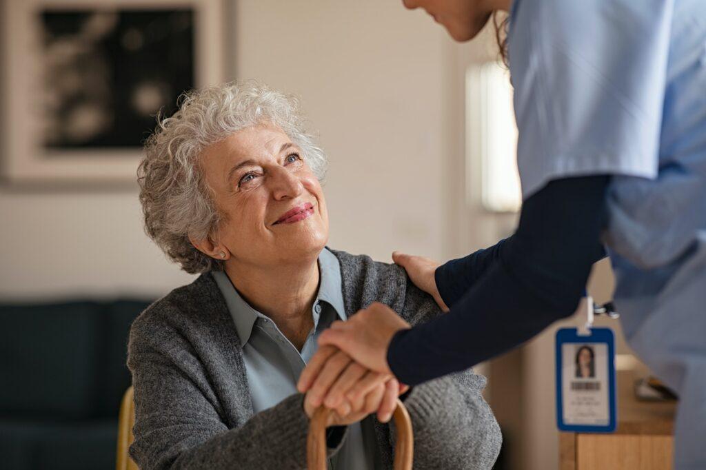 Nurse take care of senior woman
