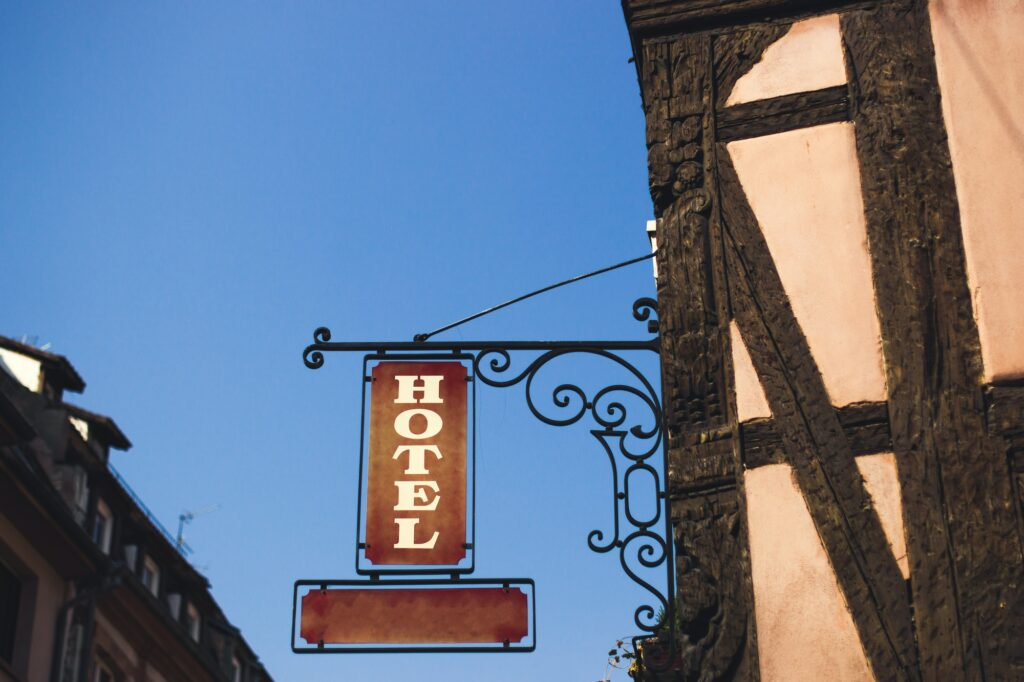 Old sign hotel at the street