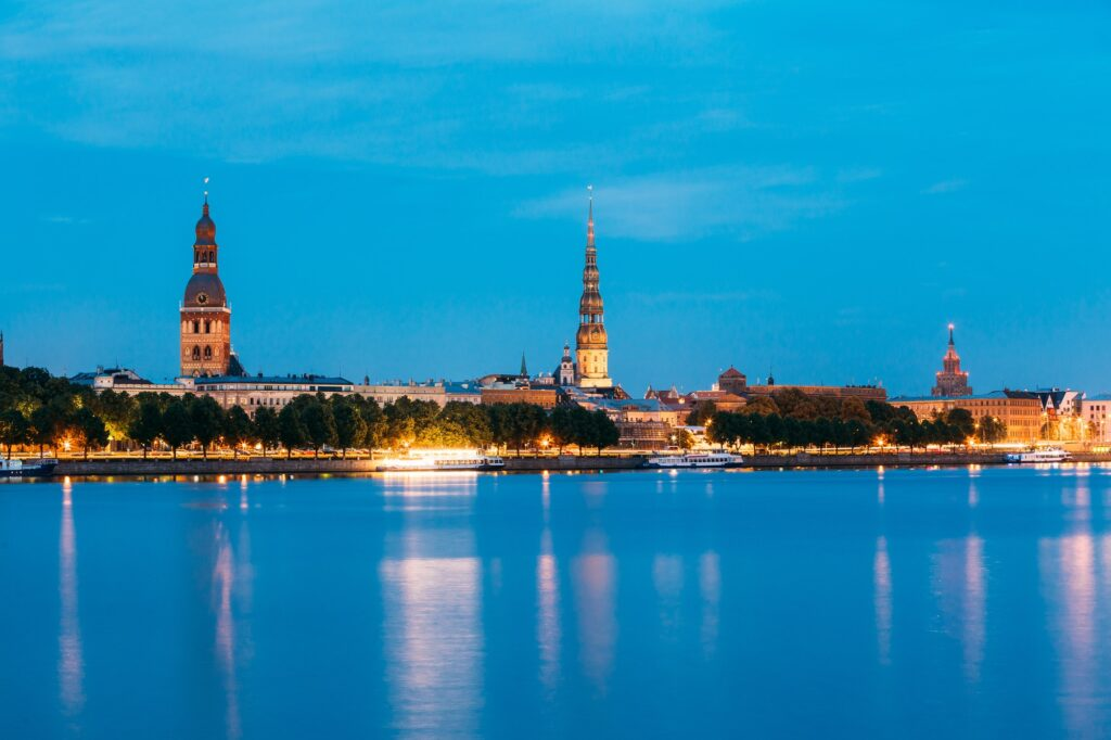 Riga, Latvia. Towers Of Riga Dome Cathedral And St. Peter's Chur