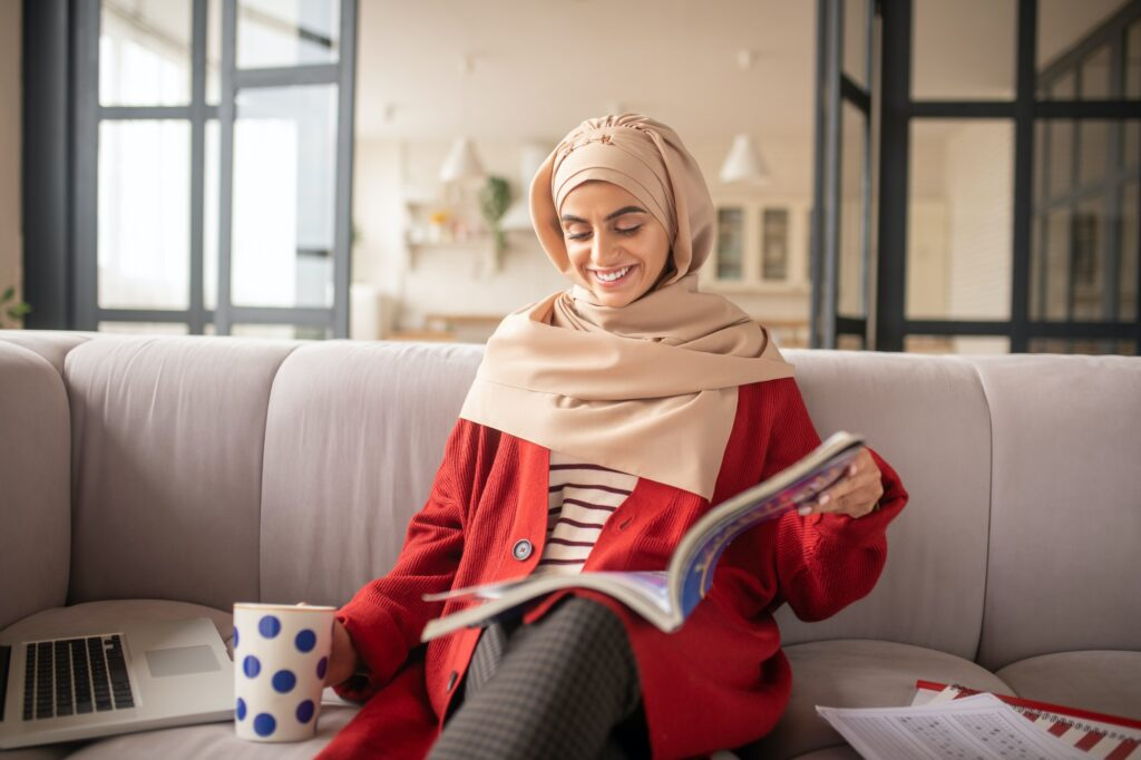Smart girl feeling relaxed while learning English