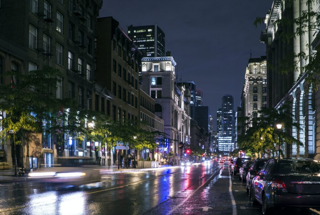 Traffic in wet cityscape at night