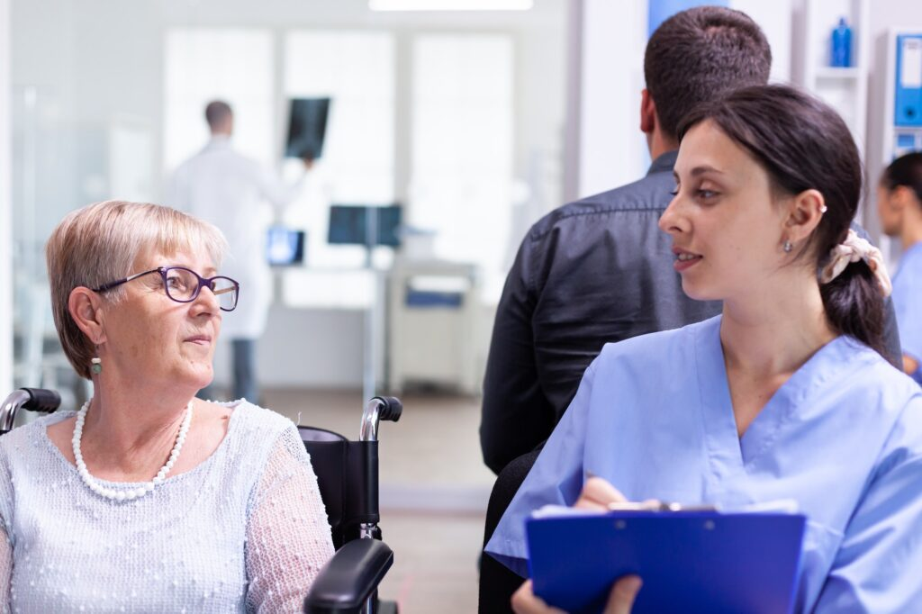 Disabled woman discussing with nurse