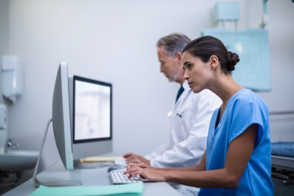 Doctor and nurse working on computer
